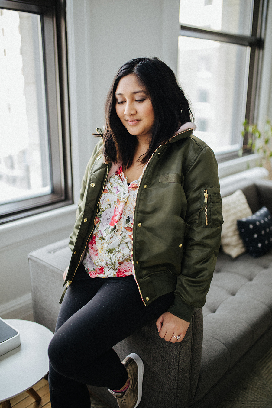 This green jacket caught my attention because of all its detailing: gold hardware, satin fabric, and a fluffy pink collar.