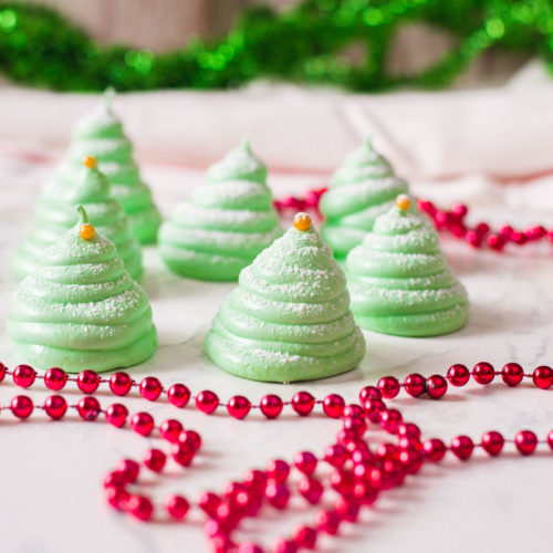 These Christmas Tree Meringue Cookies are a real stunner - and will complete any holiday dessert table! They're unique and eye-catching. Your guests will surely love these sweet treats!