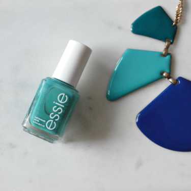 A teal shade by Essie to go with a coral dress