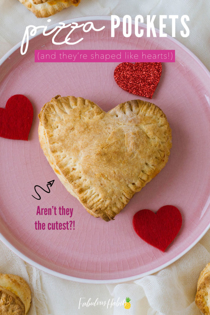 These homemade pizza pockets are heart-shaped and absolutely adorable! #valentinelunchideas