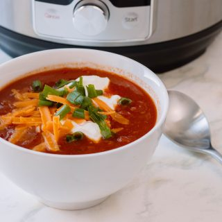 A warm bowl of chili in a crisp white bowl using the Instant Pot. Here is our very own recipe for Instant Pot Chili