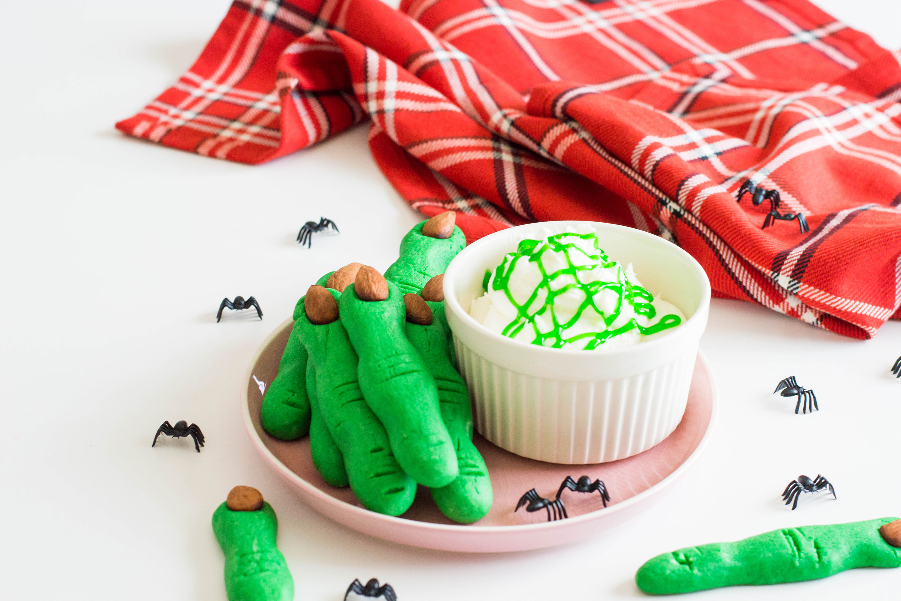 These Witch Finger Cookies are not for the faint of heart - add the extra 'creep factor' in your upcoming Halloween party with these super green treats! #halloweendesserts