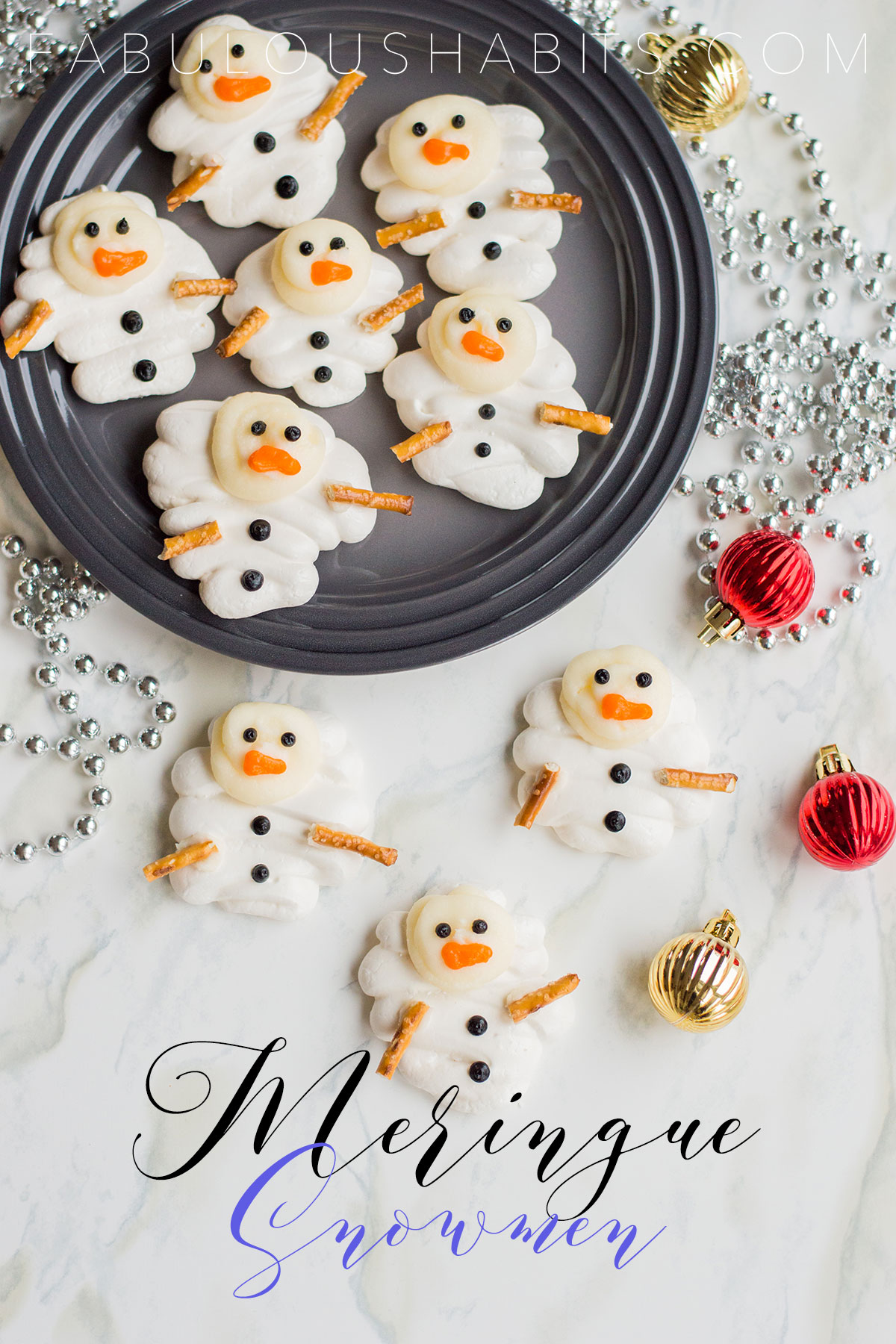 These meringue snowmen cookies will be the showstopper at your upcoming holiday party. Check out our step-by-step instructions on how to whip them up! #meringuecookies